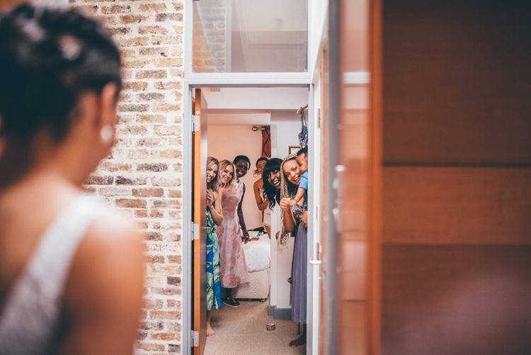 Bride and her bridal party getting ready together ahead of the big day