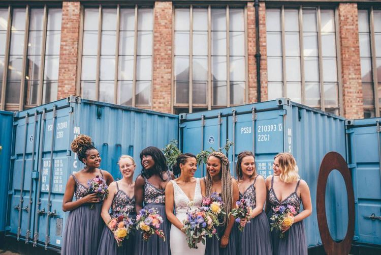 Bride and her bridesmaids with beautiful pink and purple bouquets