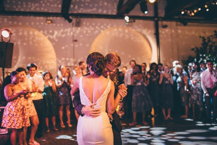 Bride and grooms first dance with fairy light backdrop
