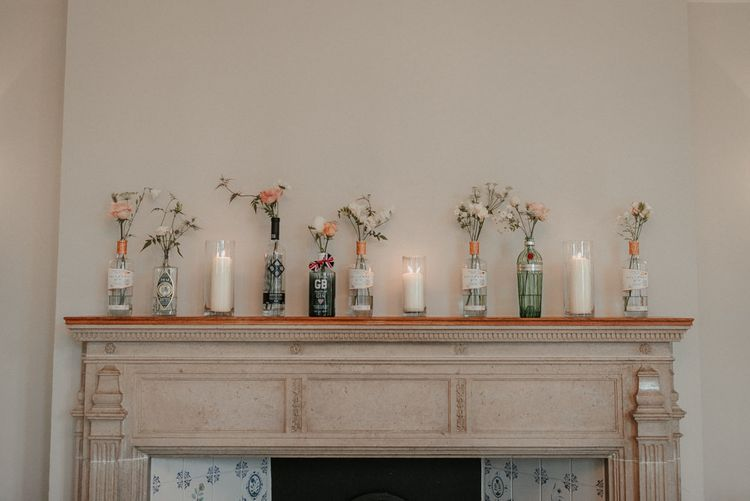 Wedding Flower Stems In Individual Glass Jars With Candles