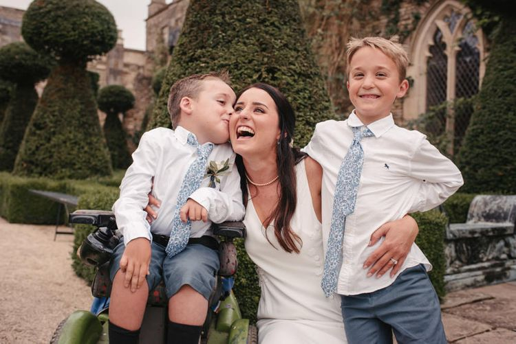 Page Boys In Blue Shorts With Floral Ties // The Lost Orangery Wedding Venue With Bride In Aston Dress By Rime Arodaky With Groom In Reiss And Images From McGivern Photography