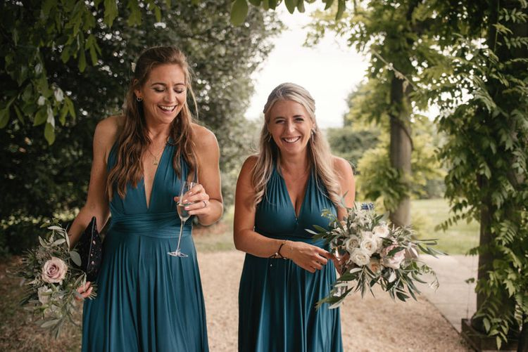 Bridesmaids In Teal Multiway Dresses By Twobirds // The Lost Orangery Wedding Venue With Bride In Aston Dress By Rime Arodaky With Groom In Reiss And Images From McGivern Photography