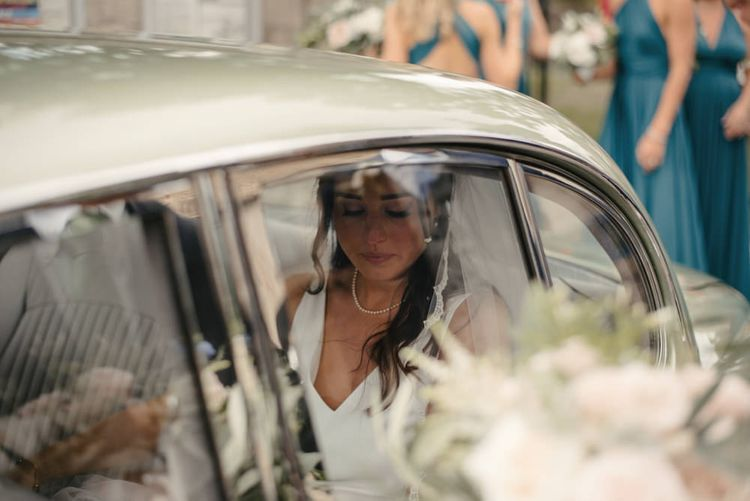 Bride Arriving At Church For Wedding // The Lost Orangery Wedding Venue With Bride In Aston Dress By Rime Arodaky With Groom In Reiss And Images From McGivern Photography