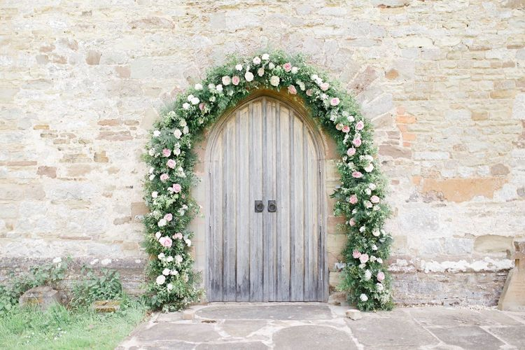 Pink rose church floral arch wedding flowers