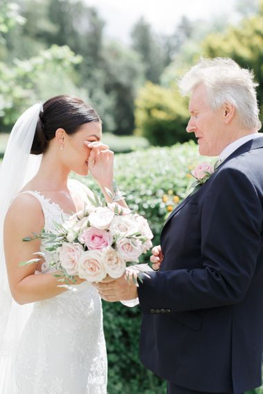 Emotional bride with her father before the church wedding ceremony