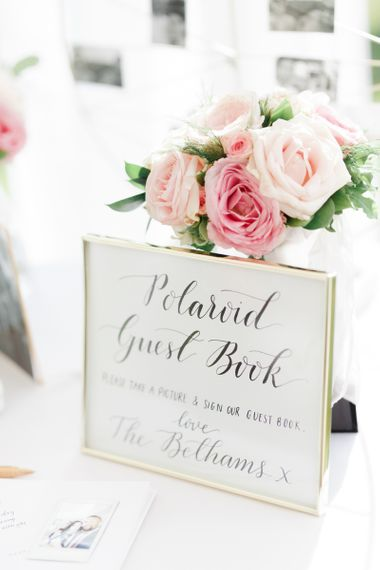 Polaroid guest book wedding sign in gold frame