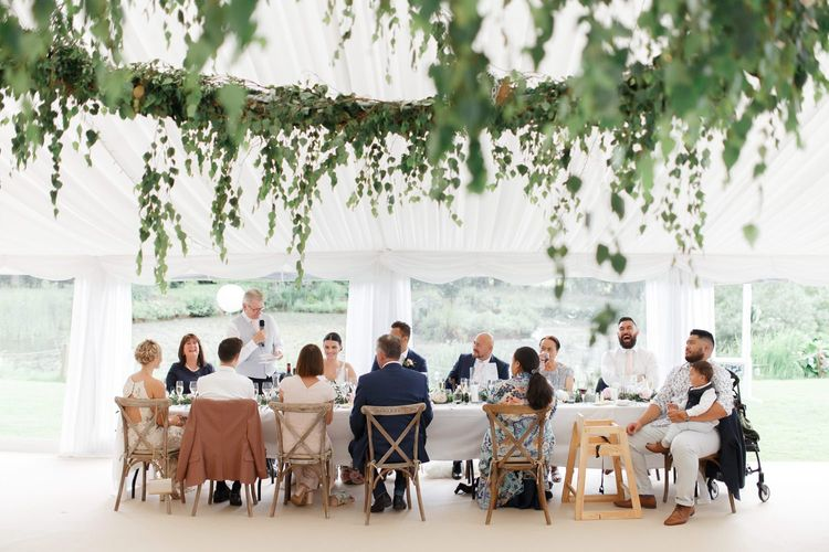 Wedding guests at Coddington Vineyard marquee reception