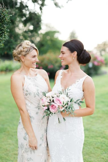 Bride and her Maid of Honour in floral dress
