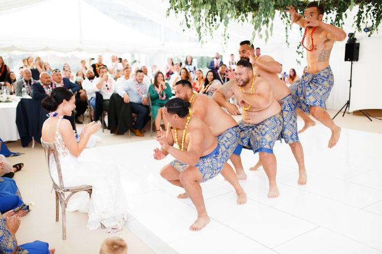 Groom and groomsmen performing a Samoan dance for the bride