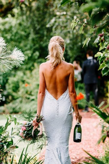 Backless wedding dress with halterneck