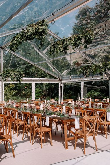 Clearspan marquee for garden wedding with beautiful decor