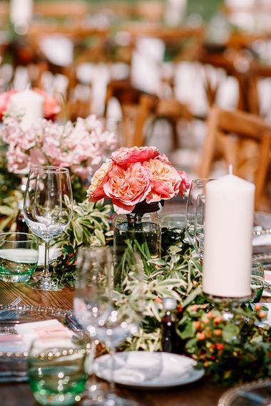 Table decor with beautiful bright flowers with David Austin roses  and candles