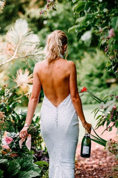 Backless wedding dress with sequins and David Austin roses bouquet