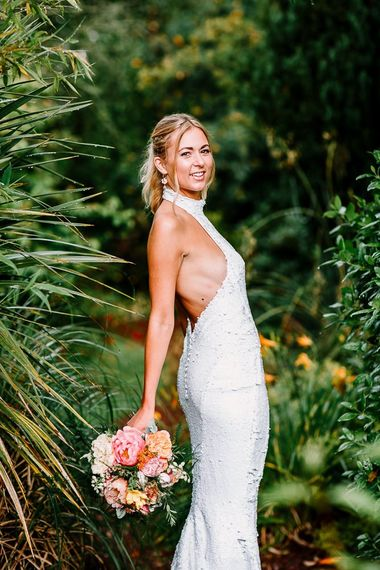 Halterneck backless wedding dress with sequins and ponytail