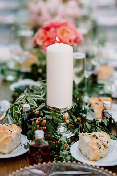 Wedding table decor with foliage, flowers and candles
