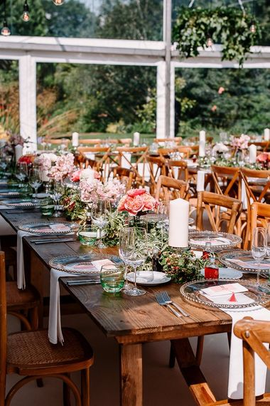 Beautiful wedding table decor with bright flowers and candles