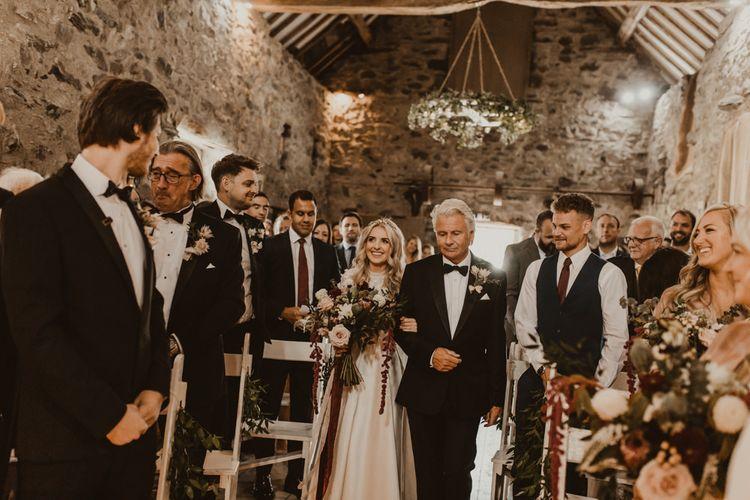 Bride walks down the aisle at Hafod Farm wedding