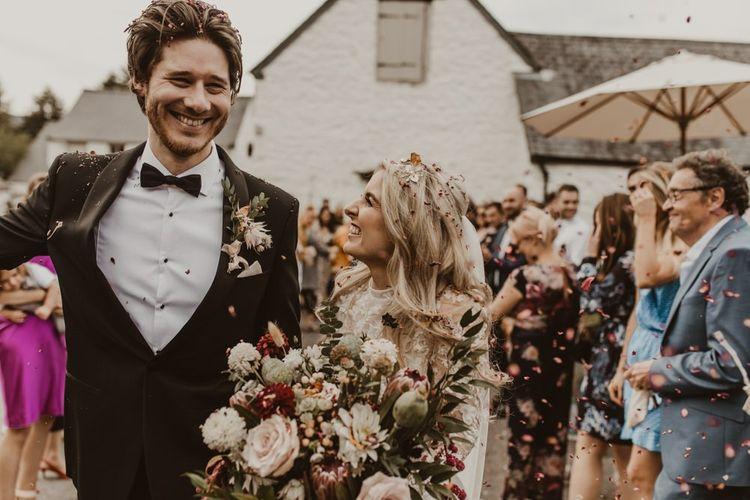 Confetti moment for bride and groom