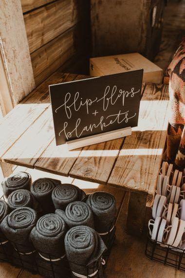 Flip flops and blankets basket for Hafod Farm wedding