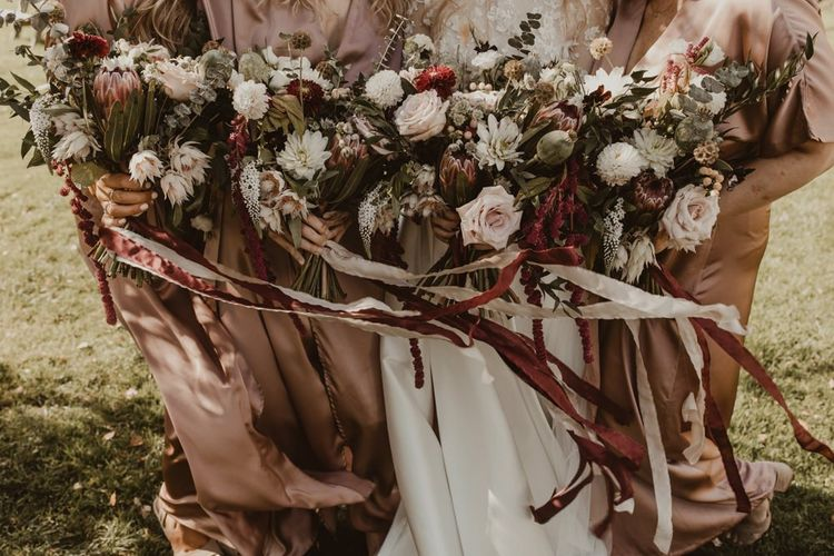 Blush wedding bouquets for bridesmaid tied with ribbons