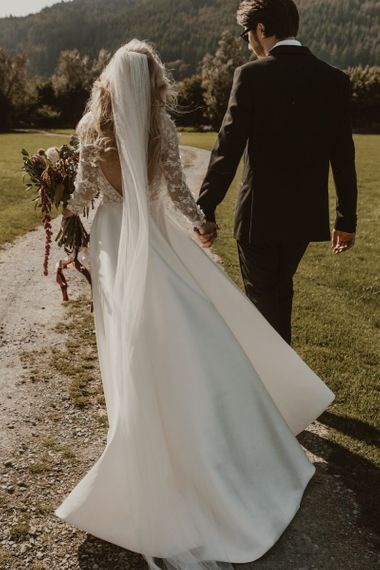 Open back wedding dress with long sleeves from Emma Beaumont