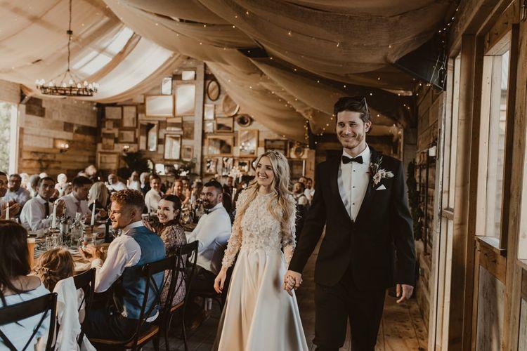 Bride and groom enter Hafod Farm wedding breakfast