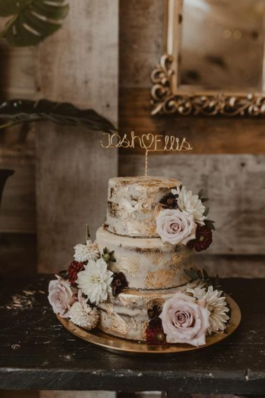 Rustic wedding cake with personalised cake topper