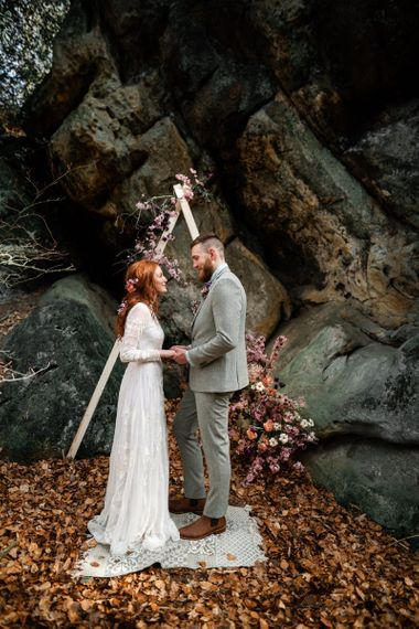 Bride in ASOS Wedding Dress and Groom in Grey Suit Exchanging Vows at Their Elopement