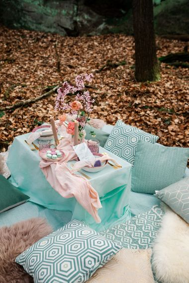 Sweetheart Table with Turquoise Linens and Cushions, Pink Macaroons and Spring Flowers