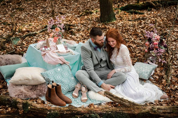 Bride and Groom Sitting at Intimate Sweetheart Grazing Table During Their Elopement