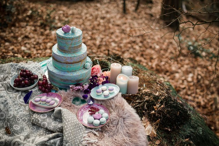 Dessert table with Macaroons and Turquoise and Gold Buttercream Wedding Cake