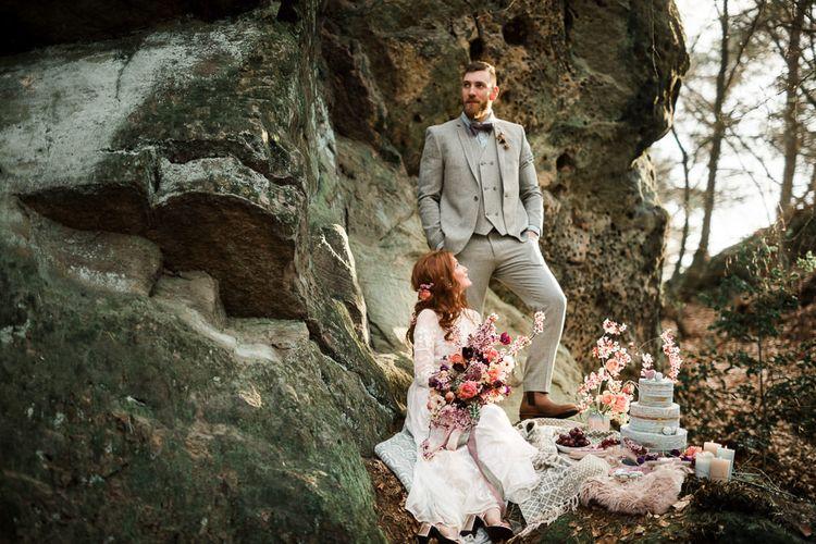 Contemporary Bride and Groom Enjoying Their Blue Wedding Cake