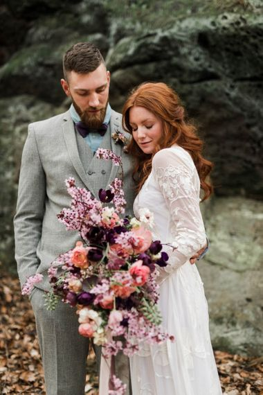 Boho Bride holding Spring Bouquet of Blossom, Tulips and Ranunculus Flowers