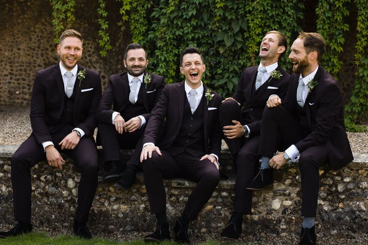 Groom and Groomsmen in Black Three-Piece Suits with Grey Ties and Personalised Tie Clips | Ivania Pronovias Wedding Dress with Long Sleeves and Minimalist Styling | Chris Barber Photography