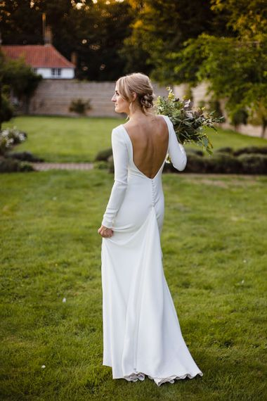 Bride in Long Sleeved Wedding Dress with Plunging V-Back and Cuff Buttons by Pronovias | Bridal Bouquet of Scabious, Ammi Majus, Veronica, Snowberries, Chocolate Cosmos, Black Scabious, Cafe au Lait Dahlias and Majolica Spray Roses with White Trailing Ribbon | Bridal Up Do | Ivania Pronovias Wedding Dress with Long Sleeves and Minimalist Styling | Chris Barber Photography