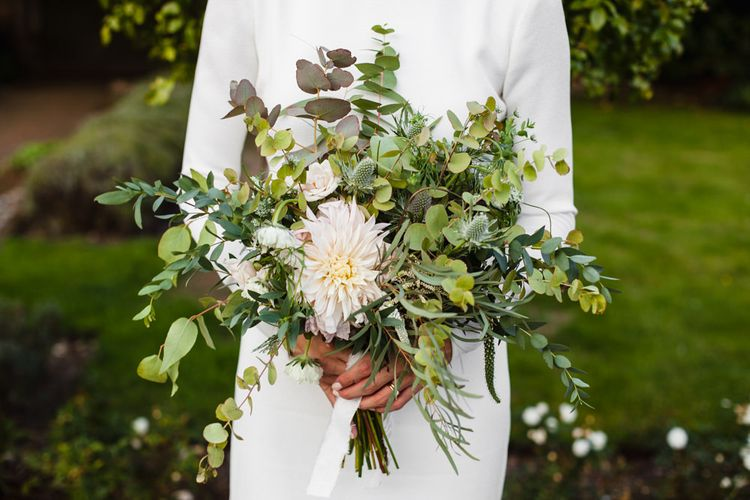 Bridal Bouquet of Scabious, Ammi Majus, Veronica, Snowberries, Chocolate Cosmos, Black Scabious, Cafe au Lait Dahlias and Majolica Spray Roses with White Trailing Ribbon | Bride in Long Sleeved Wedding Dress with Plunging V-Back and Cuff Buttons by Pronovias | Ivania Pronovias Wedding Dress with Long Sleeves and Minimalist Styling | Chris Barber Photography