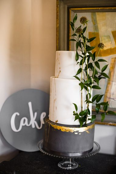 Three Tier Wedding Cake with White and Grey Icing, Gold Leaf Detail and Grey Ribbon | Ivania Pronovias Wedding Dress with Long Sleeves and Minimalist Styling | Chris Barber Photography