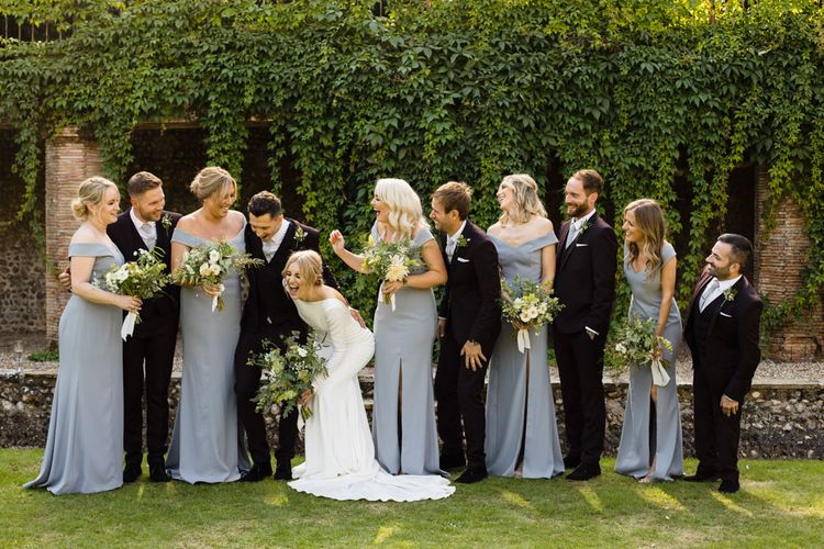 Bride in Long Sleeved Wedding Dress with Plunging V-Back and Cuff Buttons by Pronovias | Bridesmaids in Grey Off-Shoulder Dessy Dresses with Side Split | Groom and Groomsmen in Black Three-Piece Suits with Grey Ties and Personalised Tie Clips | Bouquets of Scabious, Ammi Majus, Veronica, Snowberries, Chocolate Cosmos, Black Scabious, Cafe au Lait Dahlias and Majolica Spray Roses with White Trailing Ribbon | Ivania Pronovias Wedding Dress with Long Sleeves and Minimalist Styling | Chris Barber Photography