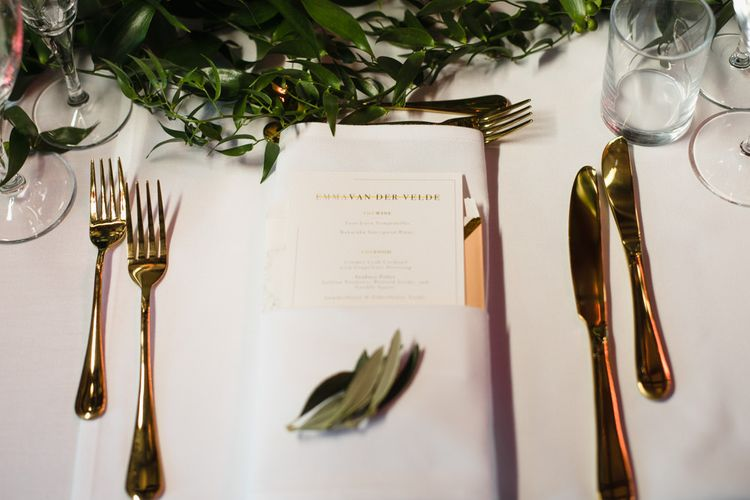 Gold Cutlery | Personalised Wedding Breakfast Menu | Eucalyptus Table Runner | Ivania Pronovias Wedding Dress with Long Sleeves and Minimalist Styling | Chris Barber Photography