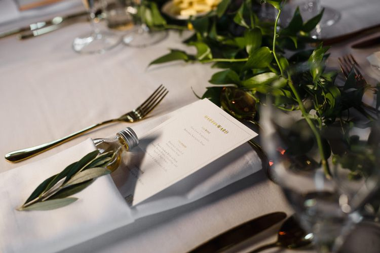 Gold Cutlery | Personalised Wedding Breakfast Menu | Shot Bottle Wedding Favour | Eucalyptus Table Runner | Ivania Pronovias Wedding Dress with Long Sleeves and Minimalist Styling | Chris Barber Photography