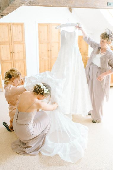 Bridal Morning Preparations   Strapless Sassi Holford Ballgown Wedding Dress with Belt   Bridesmaid in Grey Dress   Mother of the Bride in Grey Trouser Suit   Hazel Gap Barn Wedding with Bride Arriving by Kit Car   Sarah-Jane Ethan Photography
