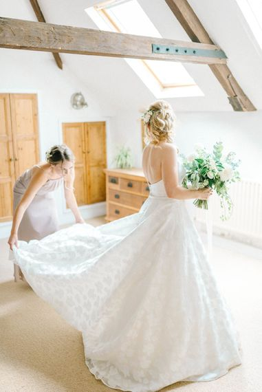 Bridal Morning Preparations   Strapless Sassi Holford Ballgown Wedding Dress with Belt   Bouquet of White Flowers and Foliage   Grey Bridesmaid Dress   Hazel Gap Barn Wedding with Bride Arriving by Kit Car   Sarah-Jane Ethan Photography