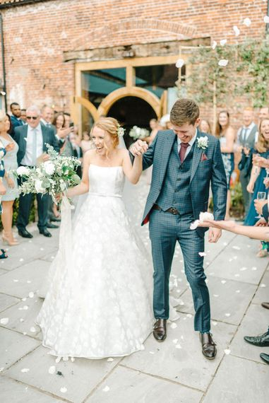 Confetti Moment   Just Married   Bride in Strapless Sassi Holford Ballgown Wedding Dress with Belt   Groom in Blue Check Paul Smith Suit   Hazel Gap Barn Wedding with Bride Arriving by Kit Car   Sarah-Jane Ethan Photography