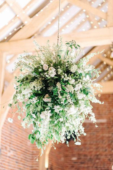 Wedding Reception Decor   Floral Ceiling Display   White Flowers and Green Foliage    Hazel Gap Barn Wedding with Bride Arriving by Kit Car   Sarah-Jane Ethan Photography
