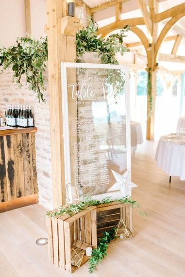 Wedding Reception Decor   Perspex Table Plan    Crates and Foliage   Hazel Gap Barn Wedding with Bride Arriving by Kit Car   Sarah-Jane Ethan Photography