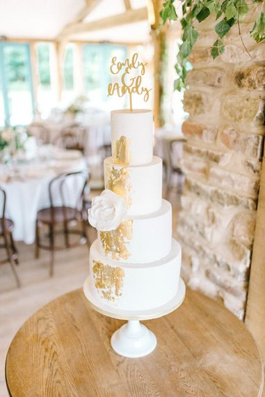 Wedding Cake   Cake Topper   Four Tiered Cake with Gold Leaf   Hazel Gap Barn Wedding with Bride Arriving by Kit Car   Sarah-Jane Ethan Photography