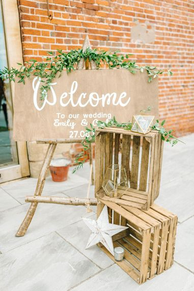 Wedding Reception Decor   Welcome Sign   Crates and Foliage    Hazel Gap Barn Wedding with Bride Arriving by Kit Car   Sarah-Jane Ethan Photography