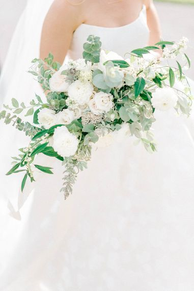 Bride in Strapless Sassi Holford Ballgown Wedding Dress with Belt   Loose Bouquet of White Flowers and Foliage   Hazel Gap Barn Wedding with Bride Arriving by Kit Car   Sarah-Jane Ethan Photography