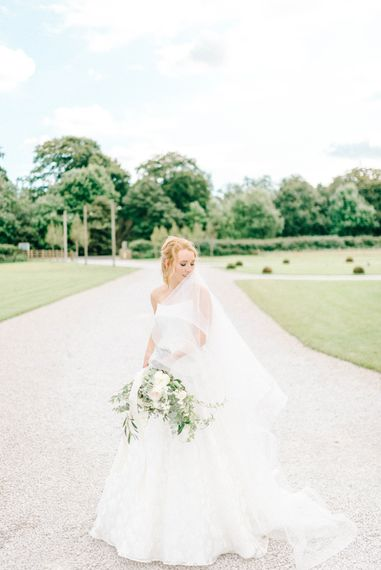 Bride in Strapless Sassi Holford Ballgown Wedding Dress with Belt   Loose Bouquet of White Flowers and Foliage with White Trailing Ribbon   Hazel Gap Barn Wedding with Bride Arriving by Kit Car   Sarah-Jane Ethan Photography