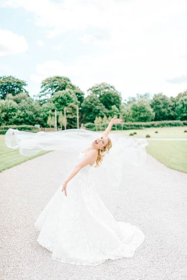 Bride in Strapless Sassi Holford Ballgown Wedding Dress with Belt   Hazel Gap Barn Wedding with Bride Arriving by Kit Car   Sarah-Jane Ethan Photography